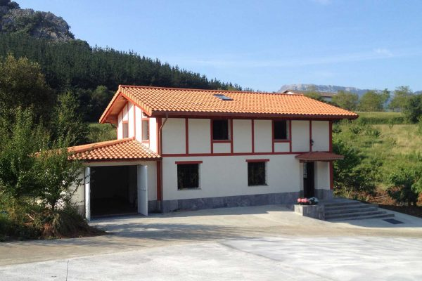 reforma fachada lateral alaya alaya taldea arquitectura mondragon